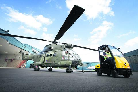 The first of the new Puma helicopters is wheeled from the Eurocopter hangar at Oxford Airport Pictures: OX54266 Damian Halliwell