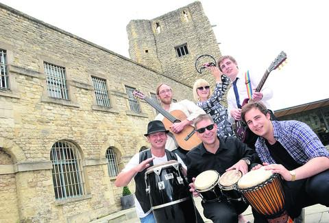 From left, Tim Aspin, Alex Ogg, Tim Hughes, music editor of the Oxford Mail and The Oxford Times, Katie-Louise Herring, Pete Hughes and Tom Beddow at Oxford Castle