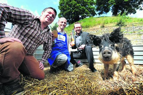 Pictured from left are John Osbourne of Porkers Done Proper, with his rare breed Manglaitza pig, Gordon Piggott of McCarthy's fruit and veg in the Covered Market, and Tanner Efinger, manager of Malmaison Brasserie