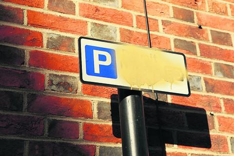 Vandals deface signs to avoid parking fines