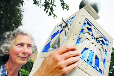 thisisoxfordshire: Garden designer Kathy Shock pictured with sculptor Harriet James's Portland stone cube sundial and column