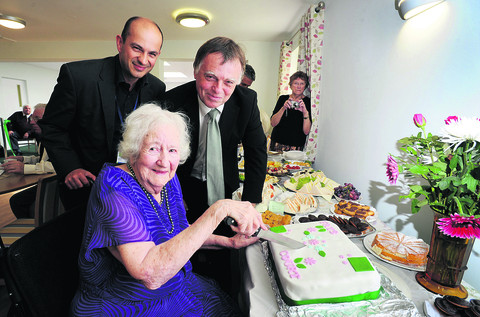 Andrew Smith is pictured, right, with GreenSquare Group head of supported housing Martin Melllors and the oldest resident Mrs Winifred Cadle, 94, as she cuts a celebratory cake.