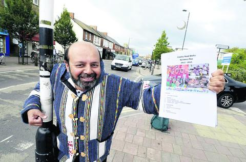 thisisoxfordshire: Carnival book-keeper and trustee Zaheer Qureshi with the business plan for next year's event