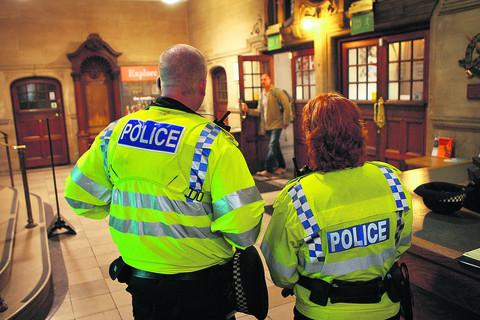 Police stand guard inside Oxford Town Hall after a gun threat was received by the city council earlier this month. Picture: OX54675 Antony Moore
