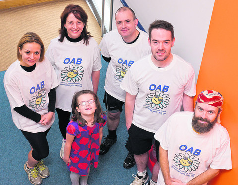 From left, the Oxfordshire Association for the Blind Half Marathon team, Laura Howdill, Rebecca Benney, Sean Rainey, Liam Kilby and Pete Thompson wih Klara Rainey, six. Picture: OX54670 Greg Blatchford