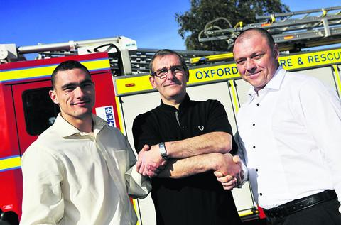 thisisoxfordshire: Pat McDonald, centre, thanks Bartosz Pytko, left, and Artur Biegala who pulled him from the plastics fire at Enstone