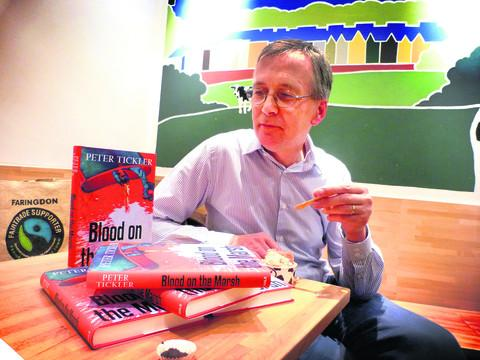 Author Peter Tickler, with his latest book Blood on the Marsh at the George and Delilah's, eating blood orange ice cream