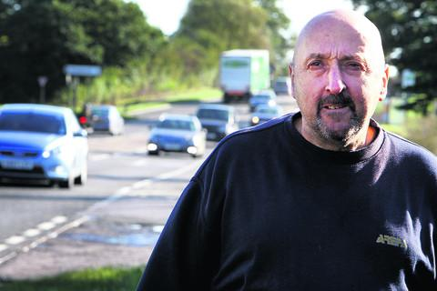 Witney councillor and haulier Steve Hayward beside the A40 at Eynsham
