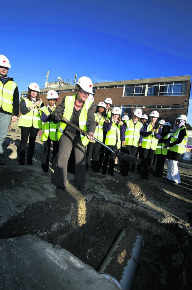 thisisoxfordshire: Principal Sue Croft, pictured burying the capsule