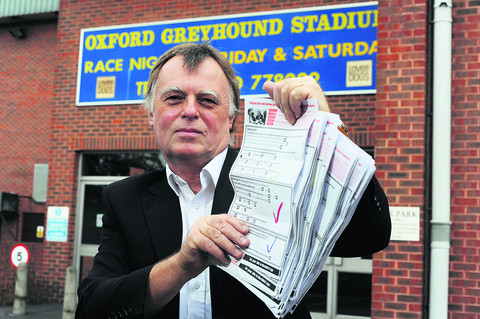 MP Andrew Smith with copies of his survey at the Oxford Stadium