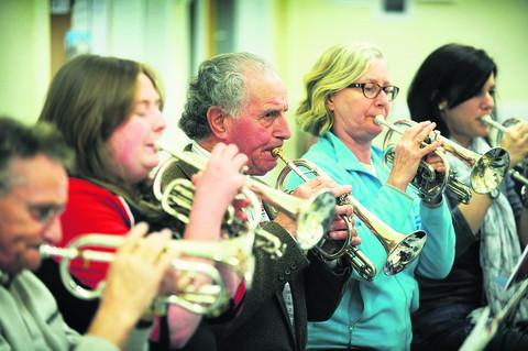 Veteran band leader and cornet player Frank Wolff, centre, has been involved in the City of Oxford Silver Band for nearly 60 years. Picture: OX54890 Jon Lewis