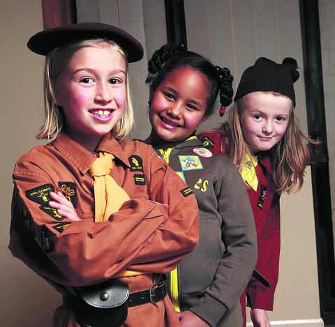 thisisoxfordshire: 6th Oxford Brownies, from left, Alexia Roberts, nine, in the 1934-66 uniform, Kazmin Vincent, seven, in current uniform, and Ruby Crocker, seven, in the 67-90 uniform