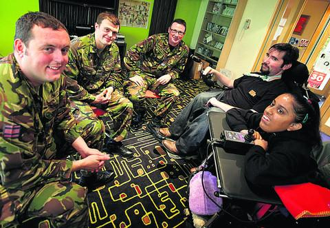 thisisoxfordshire: Lance Corporal Stephen Okey, L Cpl Stephen Kelly and Chief Technician Fraser Rutter with Matt O'Sullivan and Radha Dodhia at Douglas House