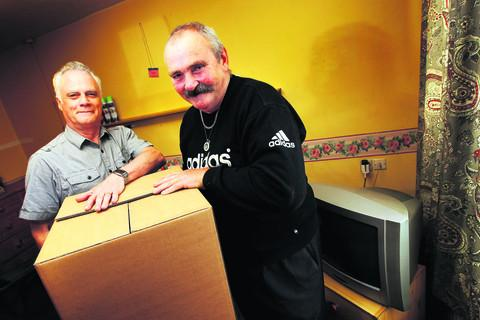 thisisoxfordshire: Jack Crompton, voids property officer at the council, left, is pictured with Malcolm Everton, the last person to move out of Bradlands on Friday