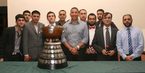 thisisoxfordshire: East Oxford line up with Phillip DeFreitas and the hefty Division 1 trophy