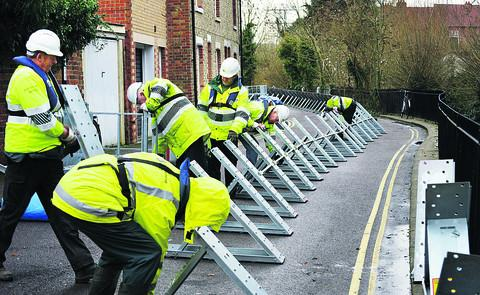 thisisoxfordshire: Flood barriers being installed at Osney Island in December 2012 during a previous flood warning period