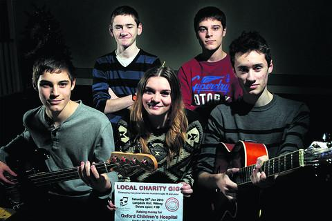 From left, Jack Francis, 12, Steve Wright, 15, Kizzy Horgan,16, Charlie Francis, 15, and Dan Wright,18, are taking part in a fundraising gig for Oxford Children's Hospital. Picture: OX56630 Ric Mellis