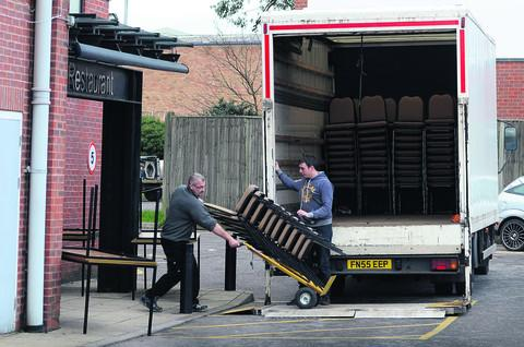 Removal men take furniture from Oxford Stadium. Picture: OX56721 Marc West