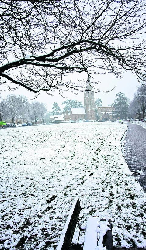Snow carpets Church Green in Witney