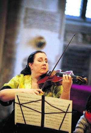 Dr Nicole Brockmann plays her viola at Christ Church Cathedral. Picture: OX56767 David Fleming