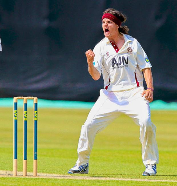 Jack Brooks celebrates a wicket for his former county Northants