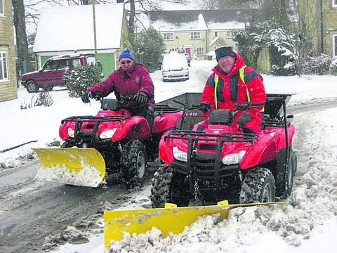 Deputy mayor Mike Tysoe, left, and John Osmond on the quad bikes