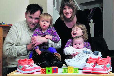 thisisoxfordshire: READY TO RUN: Nathan and Kay Thomas will be on the starting line for the OX5 Run to say thanks for the treatment their children, Molly, three, Daisy, one, and 10-week-old Emily received at the Oxford Children's Hospital