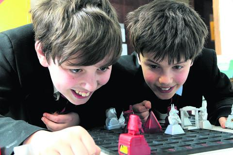 Joe Defillion, left, and Charlie Davis, both 11, from Magdalen College School. Picture: OX57040 Ric Mellis