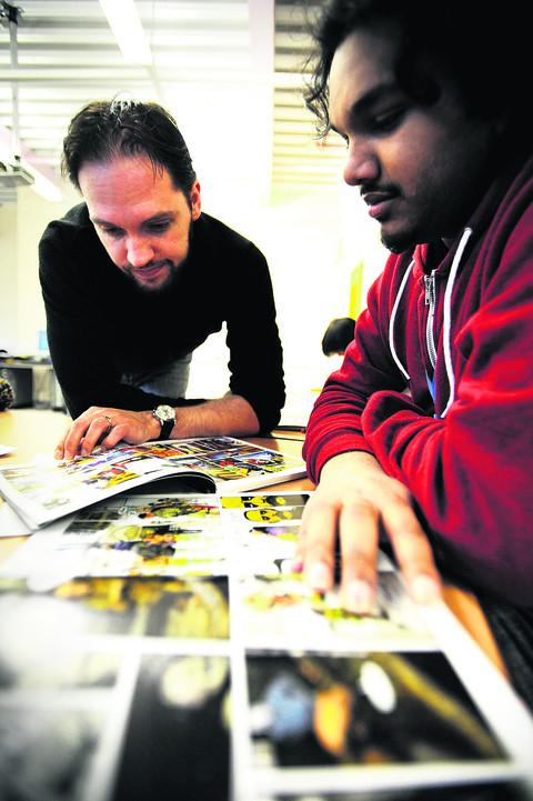 Matt Smith, editor of 2000 AD, discusses ideas with Sachin Sundar