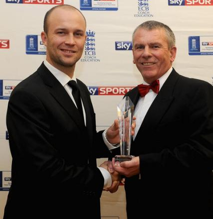 Radley College head coach Andy Wagner (right) receives the Sky Sports ECB coach of the year award from England batsman Jonathan Trott