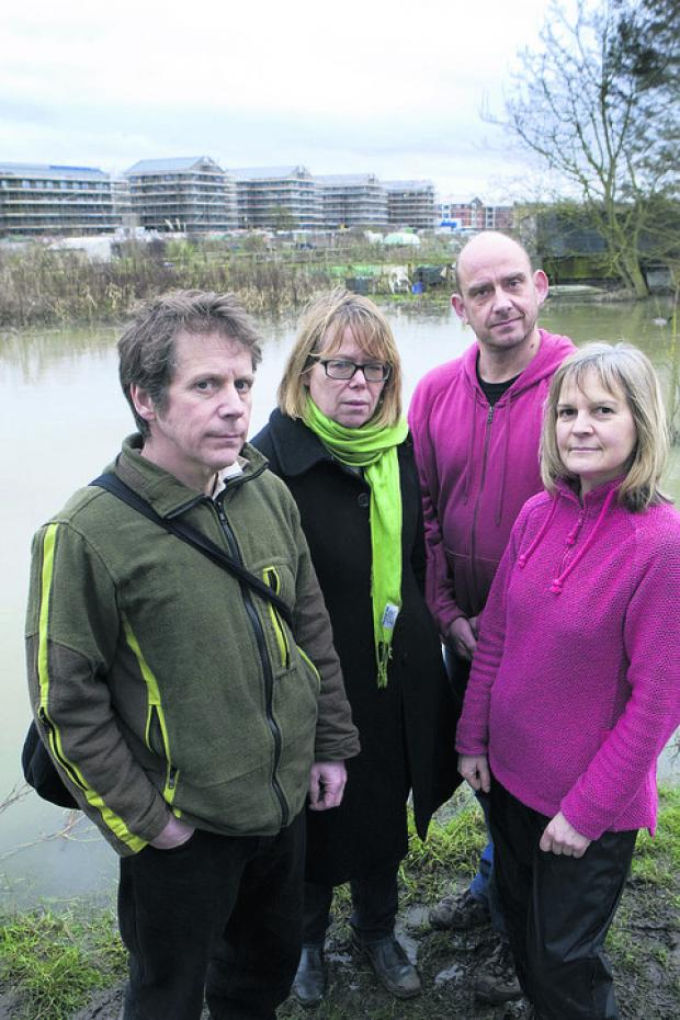 Port Meadow campaigners in front of the controversial buildings. From left, Richard Luff, Sietske Boeles, Toby Porter and Rhian Jones