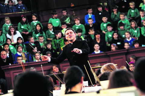 Dr John Traill conducts the annual New Year Schools' Concert at the Sheldonian Theatre, Oxford. Picture: OX57144 Ed Nix