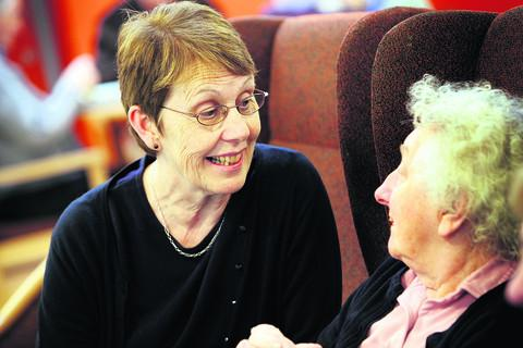 Vale House manager Tricia O'Leary, left, chats with resident Marjorie Duffield