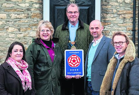 From left, Esmee Quinten of Weekly Home, Jeanette Howse, Woodstock mayor Brian Yoxall, centre, Weekly Home managing director Kelvin Fowler and Chris Baylis, chairman of Wake up to Woodstock Picture: Pawel Sytniewski