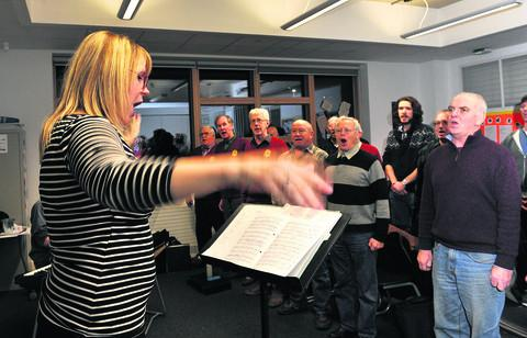 Musical director Helen Swift conducts the choir