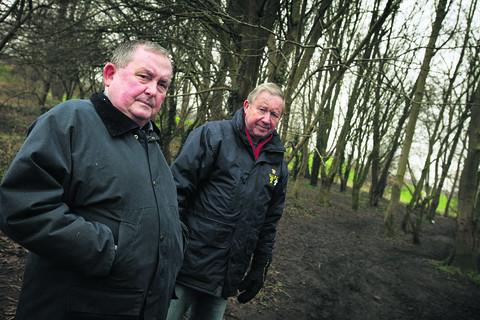 Parish councillors Brian Lester, left, and Gordon Roper at the area of Spindlebury Nature Reserve where they hope to have lights installed