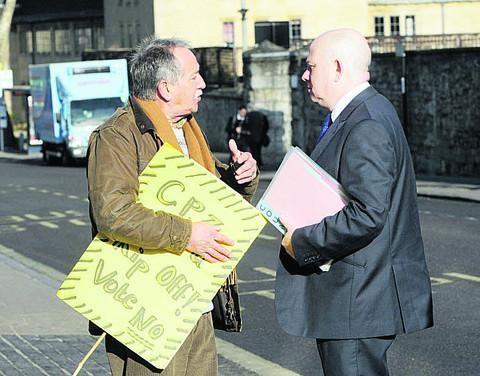 Barber Dennis Pratley, left,  who confronted Cllr Ian Hudspeth, the then cabinet member for transport – now county council leader –  in 2011, when the CPZ was first being debated at County Hall