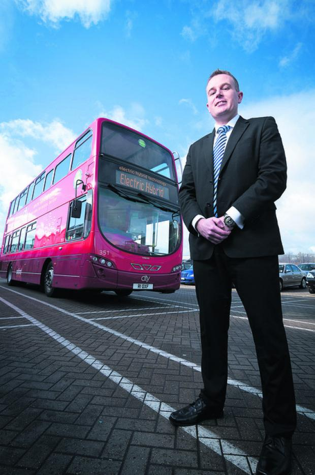 Commercial manager Andrew Morison with one of Oxford Bus Company's new hybrid buses. Picture: OX57382