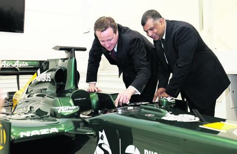 Prime Minister and Witney MP David Cameron with chairman of the Caterham group, Tony Fernandes, during a visit to the Caterham Formula 1 racing team at Leafield yesterday