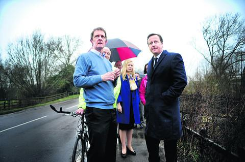 Richard Sonley, Jonathan Leggett, Ian Leggett, Nicola Blackwood and David Cameron walk alongside the B4044 towards Swinford toll bridge
