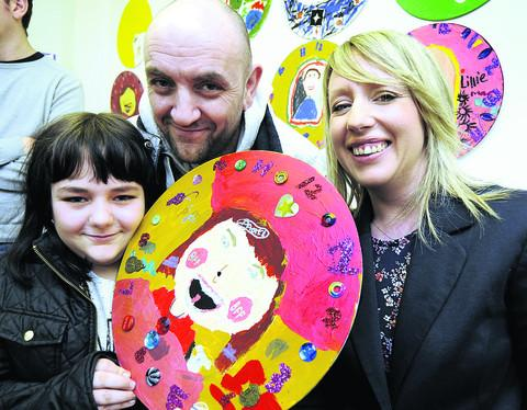 LIFELINE: Charley-Paige Arnold, nine, with her self-portrait clock and her dad Keith Arnold with Art Room manager Angela Stattersfield