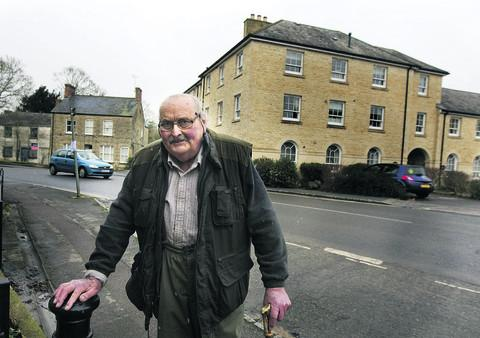 Bampton resident Adrian Simmonds, whose photographs feature in the exhibtion, in front of Thornberry, which stands on the site of the old Market Square Garage