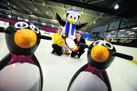VIDEO STARS: Oxford Ice Rink manager John Harris, in costume as Marvin the Penguin, with staff Kerry Wood and Luke Spicer