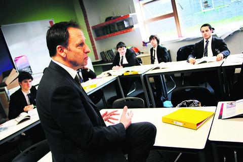 Principal David Brown teaches a class at Oxford Academy