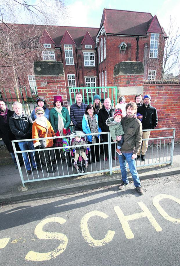 Parents object to bid to merge schools