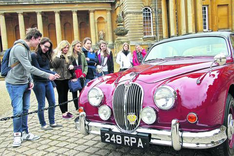 Our Lady's Abingdon students examine the Jaguar at Blenheim Palace. Picture: OX58006 Ric Mellis