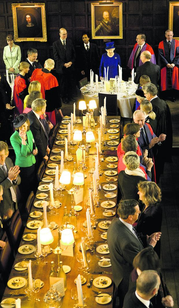 thisisoxfordshire: The Queen makes her way to her table at Oriel College
