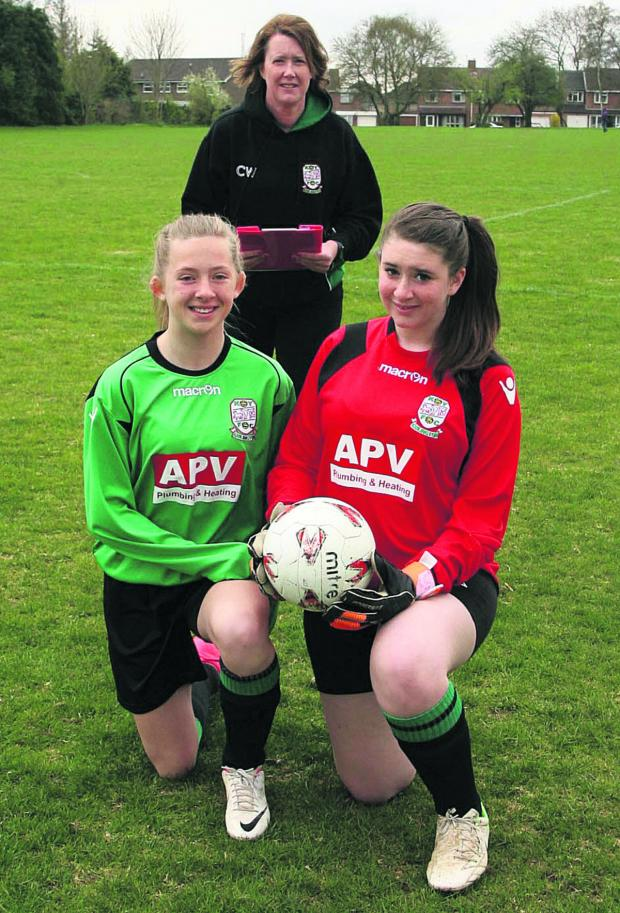 thisisoxfordshire: COMMITMENT:  Kidlington coach Caroline Whitfeld with players Abi Haynes, left, and Eleanor Whitfeld