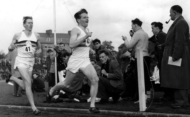 thisisoxfordshire: Chris Chataway, centre, acts as pacemaker for Roger Bannister's successful bid to beat the four-minute mile barrier at Iffley Road, Oxford, in 1954. At other times Chris and Roger strutted their stuff on the dance floor