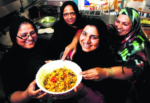 thisisoxfordshire: From left, Parveen Akhtar, Shazia Rashid, Khamim Hussain and Sajida Sultana with one of their dishes